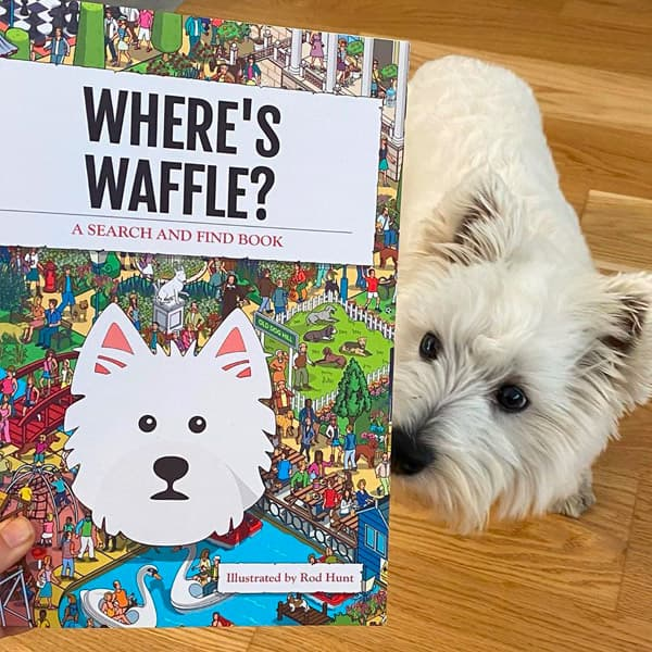Waffle the Westie looking inside his Personalised Where's Book
