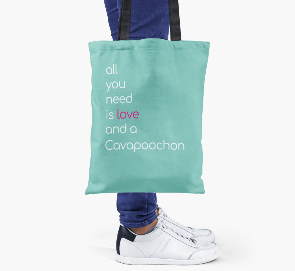 Cavapoochon All you need is love {colour} shopper bag held by woman