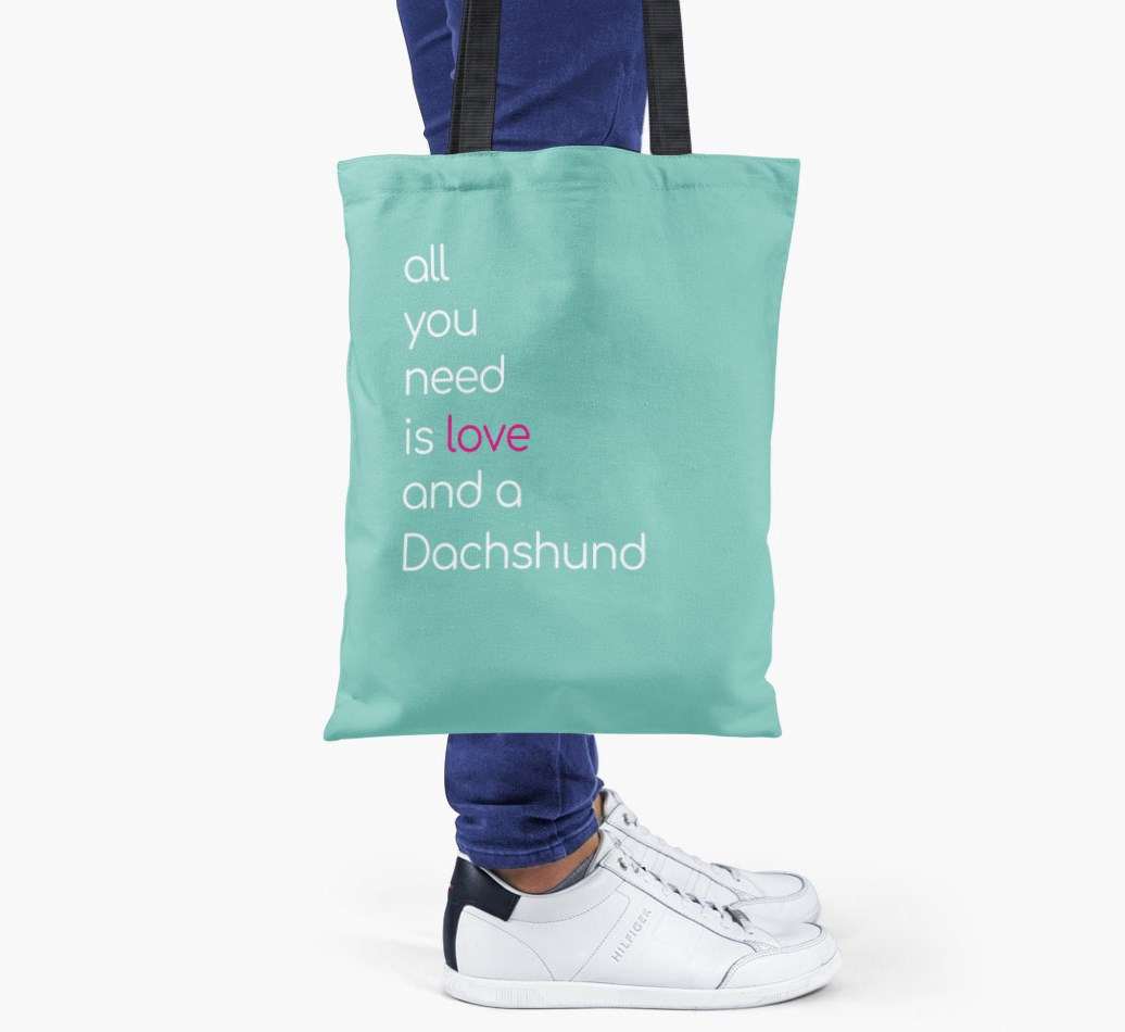Dachshund All you need is love {colour} shopper bag held by woman