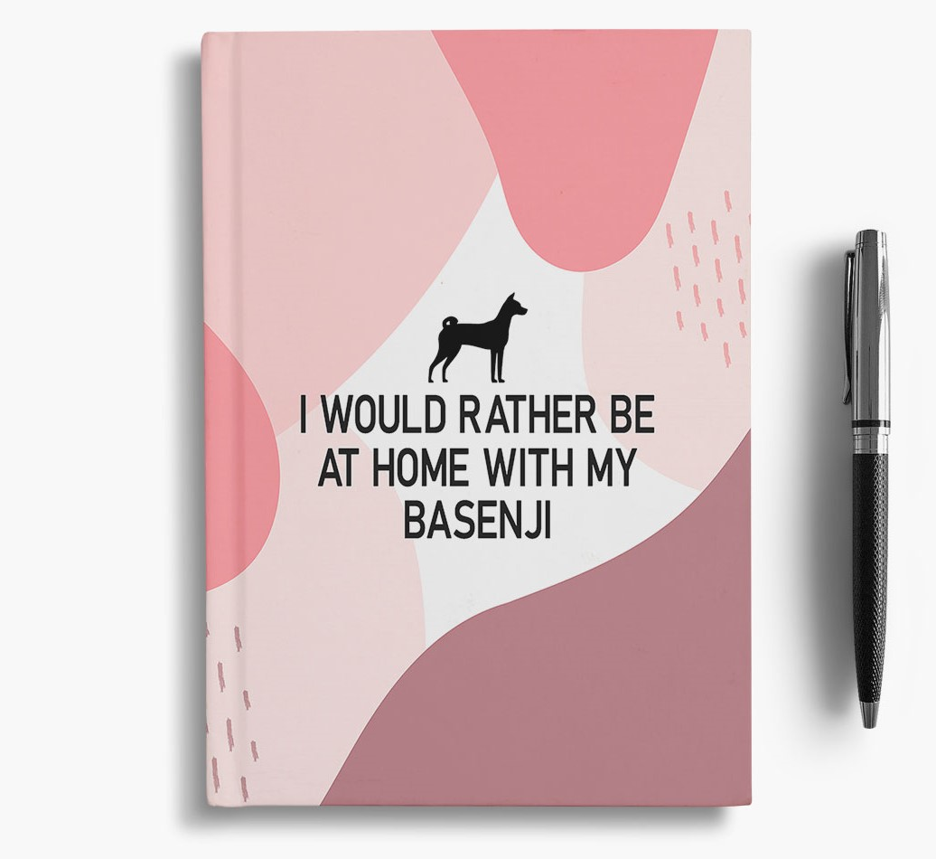 Basenji {colour} 'I would rather be at home with my Basenji' Notebook with Basenji Silhouette