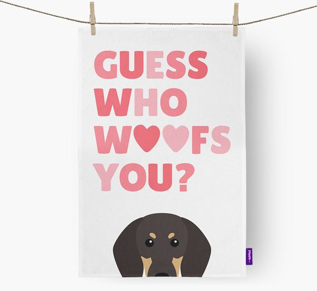'Guess Who Woofs You?' Tea Towel with Black and Tan Coonhound Icon