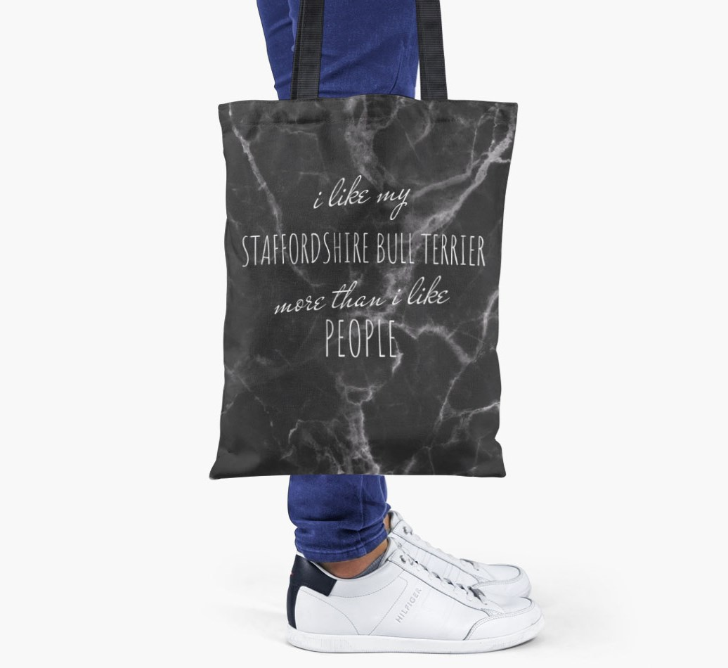Staffordshire Bull Terrier All you need is love {colour} shopper bag held by woman