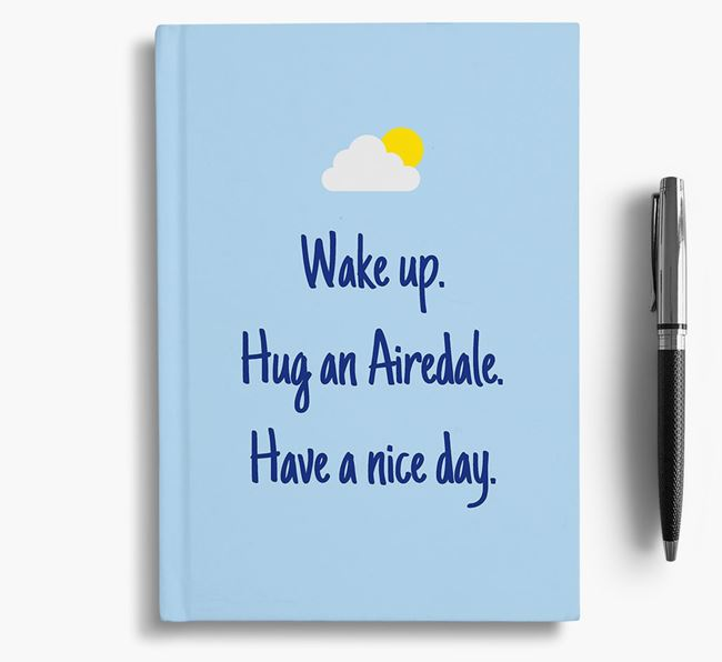 'Wake up. Hug an Airedale. Have a nice day.' Notebook