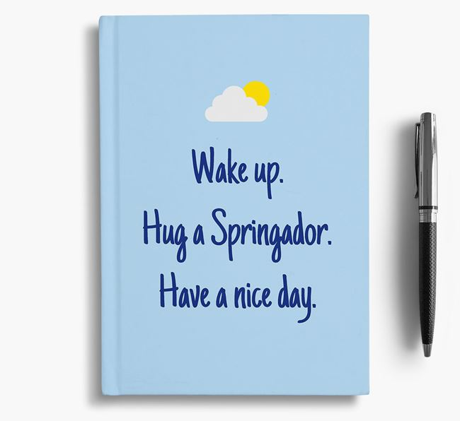 'Wake up. Hug a Springador. Have a nice day.' Notebook