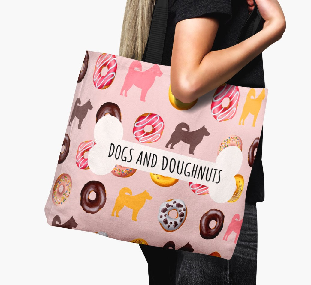 Woman holding 'Dogs & Donuts' Canvas Bag with Chow Shepherd Silhouettes