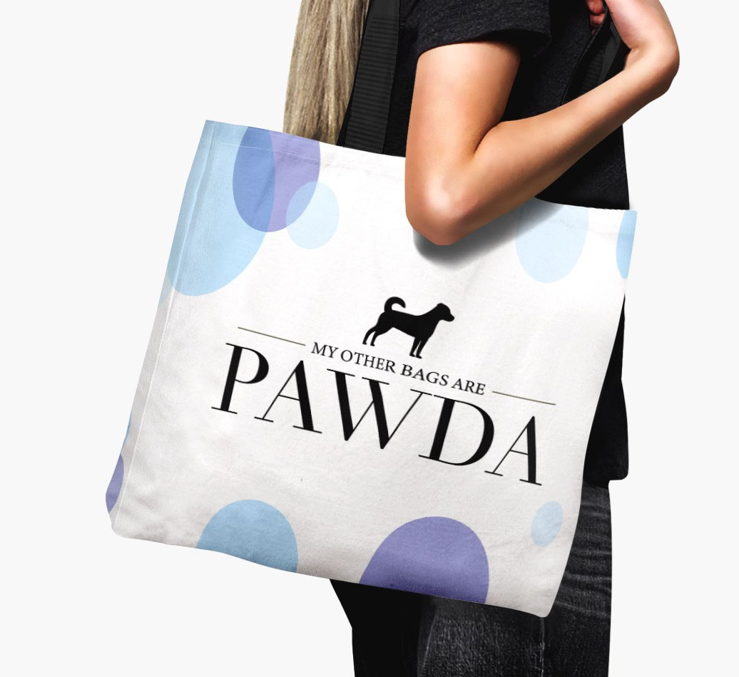Woman holding {colour} Canvas Bag 'Pawda' with Border Jack Silhouette