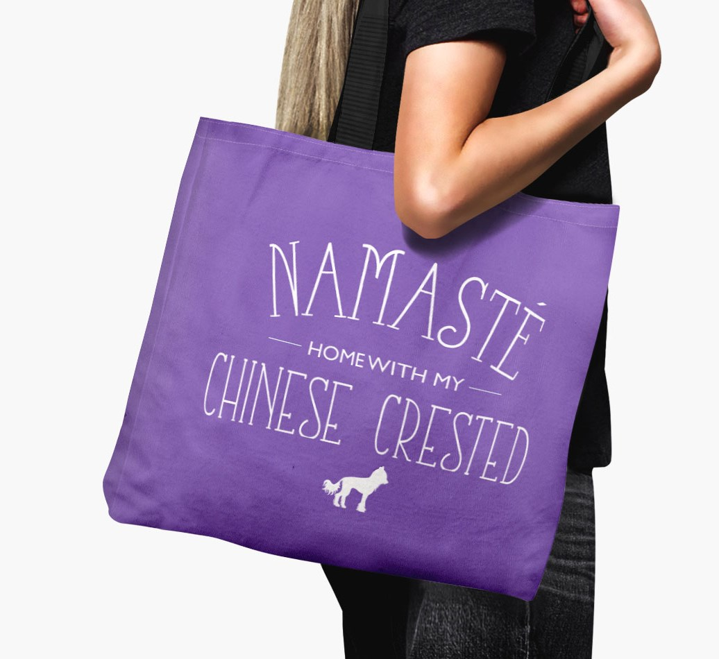 Woman holding 'Namaste home with my Chinese Crested' Canvas Bag with Hairless Chinese Crested SIlhouette