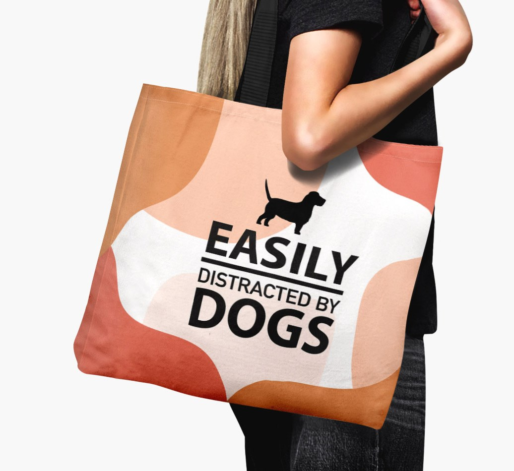 Woman holding {colour} 'Easily Distracted By Dogs' Canvas Bag with Grand Basset Griffon Vendeen Silhouette