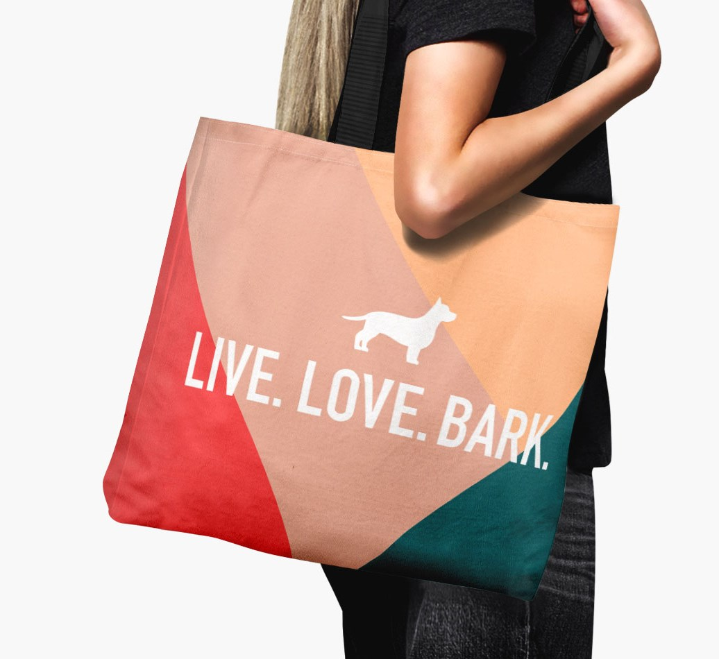 Woman holding {colour} 'Live. Love. Bark.' Canvas Bag with Chiweenie Silhouette